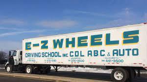 EZ Wheels Driving School logo